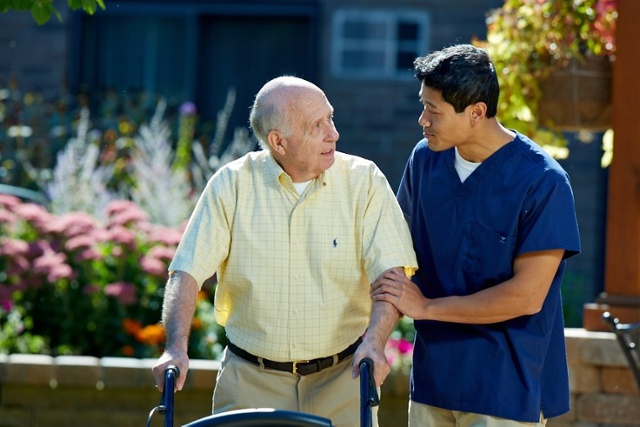 Fall Prevention for Seniors – man with walker and assistant